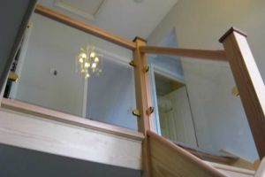 Glass balustrade with gold finish brackets, Oakley.